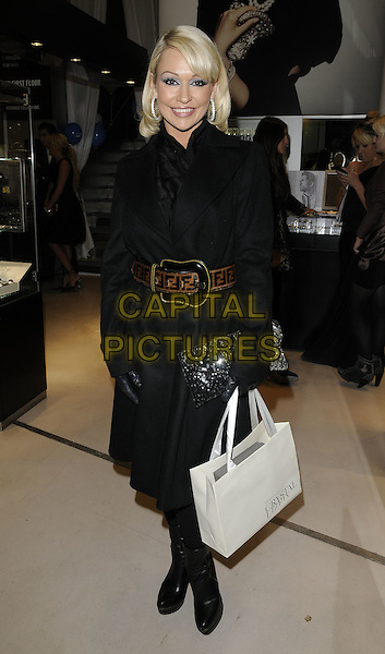 "KRISTINA RIHANOFF.""A Night With Nick"" charity event, Swarovski Crystallized Cosmos & Lounge, Great Marlborough Street, London, England..November 30th, 2010.full length black boots goody bag gloves brown belt .CAP/CAN.©Can Nguyen/Capital Pictures."