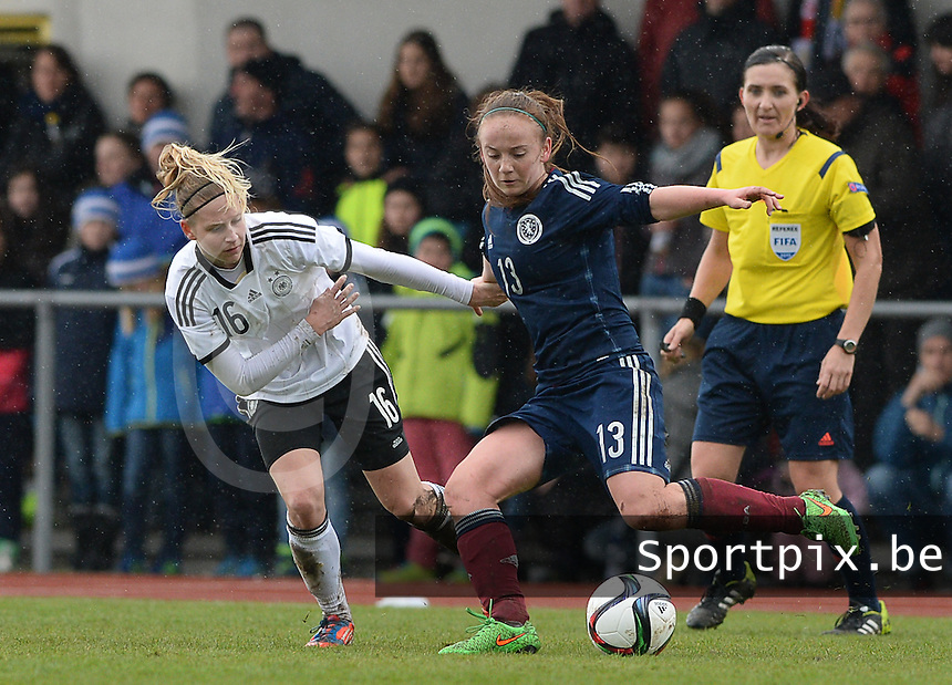 20150404 - FORST , GERMANY  : German Saskia Matheis pictured in a duel with Scottish Katey Turner (right) during the soccer match between Women Under 19 teams of Germany and Scotland , on the first matchday in group 5 of the UEFA Elite Round Women Under 19 at WaldseeStadion , Forst , Germany . Saturday 4th April 2015 . PHOTO DAVID CATRY