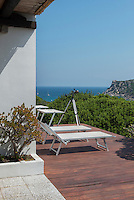 The terrace has a spectacular view of the Sardinian coast