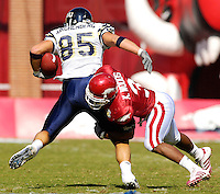 Florida International University Golden Panthers versus the University of Arkansas Razorbacks at Donald W. Reynolds Razorback Stadium, Fayetteville, Arkansas on Saturday, October 27, 2007.  The Razorbacks defeated the Golden Panthers, 58-10...FIU junior tight end Eric Kirchenberg (85) (Maywood, Ill.) attempts to break away from Arkansas safety Kevin Woods (3).