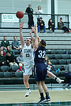 23 February 2018:  Maddie Merritt shoots past Mikaela Eppard during an NCAA women's CCIW Semi-Final basketball game between the Elmhurst Bluejays and the Illinois Wesleyan Titans in Shirk Center, Bloomington IL