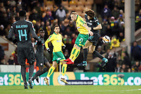 Alex Pritchard of Norwich City and David Luiz of Chelsea both go for the aerial ball during Norwich City vs Chelsea, Emirates FA Cup Football at Carrow Road on 6th January 2018