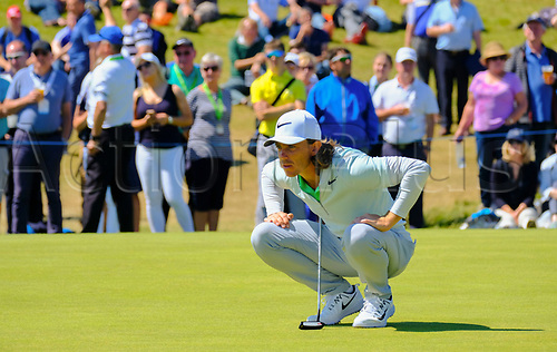 July 8th 2017, Portstewart Golf Club, Portstewart, Northern Ireland; Dubai Duty Free Irish Open Golf Championship, Day 3; Tommy Fleetwood (ENG) studies the green on the 16th during the third round of the Dubai Duty Free Irish Open