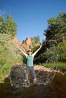 Walking and playing along an idylic desert stream bottom, South East Utah,