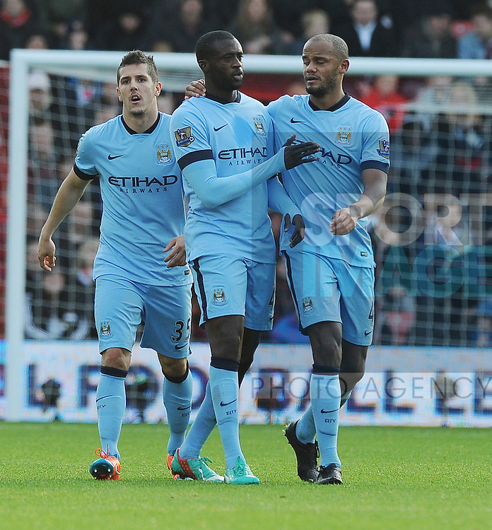 Yaya Toure of Manchester City celebrates scoring his goal to make it 1-0 with team mate Vincent Kompany of Manchester City<br /> - Barclays Premier League - Southampton vs Manchester City - St Mary's Stadium - Southampton - England - 30th November 2014 - Pic Robin Parker/Sportimage