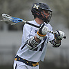 Timmy Ley #21 of Massapequa makes a pass during the first quarter of a Nassau County varsity boys lacrosse game against Farmingdale at Massapequa High School on Friday, April 27, 2018. He scored a goal early in the fourth quarter to break a 4-4 tie. Massapequa netted two more goals to win by a final score of 7-4.