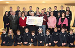 Students of Cartown National School, Parents Council, Brenda McGrane and Olivia McAuley, Principal, Gerry Campbell and teacher Shane Reilly present cheque to Clare Leonard from Down Syndrome Ireland..Photo NEWSFILE/Jenny Matthews.(Photo credit should read Jenny Matthews/NEWSFILE)....This Picture has been sent you under the condtions enclosed by:.Newsfile Ltd..The Studio,.Millmount Abbey,.Drogheda,.Co Meath..Ireland..Tel: +353(0)41-9871240.Fax: +353(0)41-9871260.GSM: +353(0)86-2500958.email: pictures@newsfile.ie.www.newsfile.ie.FTP: 193.120.102.198.