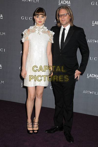 Bella Heathcote & guest.LACMA 2012 Art + Film Gala held at LACMA, Los Angeles, California, USA..October 27th, 2012.full length black suit white dress beaded high neck short sleeved tweed black strappy shoes straps peep toe gold flowers .CAP/ADM/BP.©Byron Purvis/AdMedia/Capital Pictures.