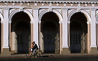 07 FEB 2003 - CIENFUEGOS, CUB - A cyclist gives a friend a lift on the crossbar of his bicycle (PHOTO (C) NIGEL FARROW)