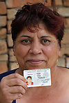 Gulten Murat shows her identity card. She lives in a largely Roma, Turkish-speaking neighborhood of Dobrich, in the northeast of Bulgaria. Although she goes by her original Turkish name, her government-issued identity card has the Bulgarian version of her name: Galena Ilieva. Some information on the card has been blurred to protect details of her identity.