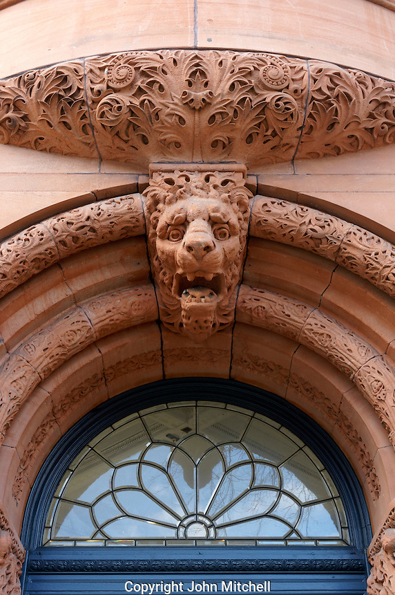 Lion sculpture decoration on ornate arched doorway of the Interurban Building in the Pioneer Square historical district, Seattle, Washington, USA