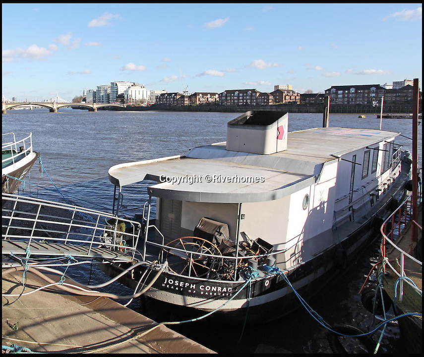 BNPS.co.uk (01202 558833)<br /> Pic: Riverhomes/BNPS<br /> <br /> Heart of Lightness - Tardis like houseboat on the Thames.<br /> <br /> A houseboat that looks more like a luxurious penthouse suite inside has gone on the market for a whopping £1.5 million - because it's in one of London's most exclusive locations.<br /> <br /> The 100ft vessel was once a former Dutch barge taking supplies up and down the Thames until it was retired from service in the 1960s and left to rot.<br /> <br /> But a decade later it was salvaged and turned into a houseboat before undergoing a complete refurbishment four years ago and moved to a premier mooring alongside one the swankiest addresses in the city.<br /> <br /> The plush houseboat, berthed at the entrance to Cheyne Walk, now boasts a lavish living room, stylish 50ft-long kitchen, a spiral staircase, two opulent bedrooms, three bathrooms and even a sun terrace.<br /> <br /> And despite its eye-watering £1.5m asking price, experts at Riverhomes estate agents say the houseboat is actually a bargain and that anyone wanting to live in such luxury in the heart of Chelsea would have to shell out many millions more.