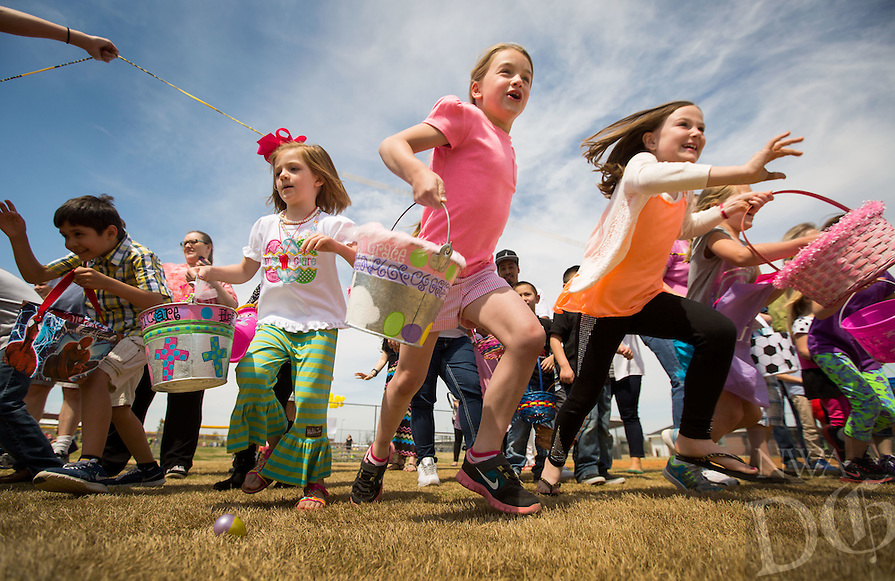 STAFF PHOTO JASON IVESTER --04-19-2014--<br /> Children take off to start Cross Church's Easter Eggstravaganza on Saturday, April 19, 2014, on the baseball fields on their Springdale campus. Children were divided into three age groups and also searched for prize eggs mixed in the bunch.