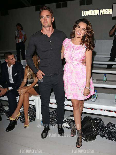 Kelly Brook and Thom Evans at the Issa catwalk show as part of London Fashion Week SS13, London. 15/09/2012 Picture by: Henry Harris / Featureflash