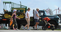 NWA Democrat-Gazette/ANDY SHUPE<br /> Fairgoers walk Thursday, Sept. 3, 2015, past a 1957 Chevrolet 6400 truck and John Deere bulldozer on display from the Arkansas Forestry Commission during the Washington County Fair at the county fairgrounds in Fayetteville.