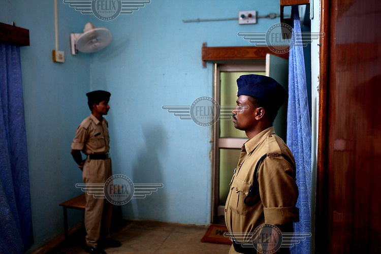 Policemen stand guard outside of Superintendent of Police (S.P.) Amresh Mishra's office in Dantewada. In 2009 an S.P. in neighbouring Rajnandgaon district was killed during a coordinated attack by Naxalite (Maoist) insurgents. /Felix Features
