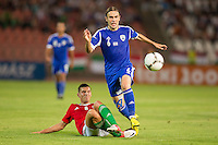 Hungary's Adam Pinter (L) and Israel's Bibars Natcho (R)  fight for the ball during a friendly football match Hungary playing against Israel in Budapest, Hungary on August 15, 2012. ATTILA VOLGYI