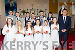 Patrick Crean, Principal of Castlegregory NS with his pupils at St Mary's church in the village last Saturday morning after they made their First Holy Communion.