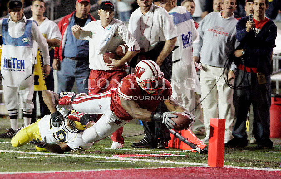 24 Sep 2005: Wisconsin running back Brian Calhoun (2), defended by Michigan cornerback Leon Hall (29), scores a touchdown in the fourth quarter of Wisconsin's 23-20 victory over the Michigan Wolverines at Camp Randall Stadium in Madison, Wisconsin.