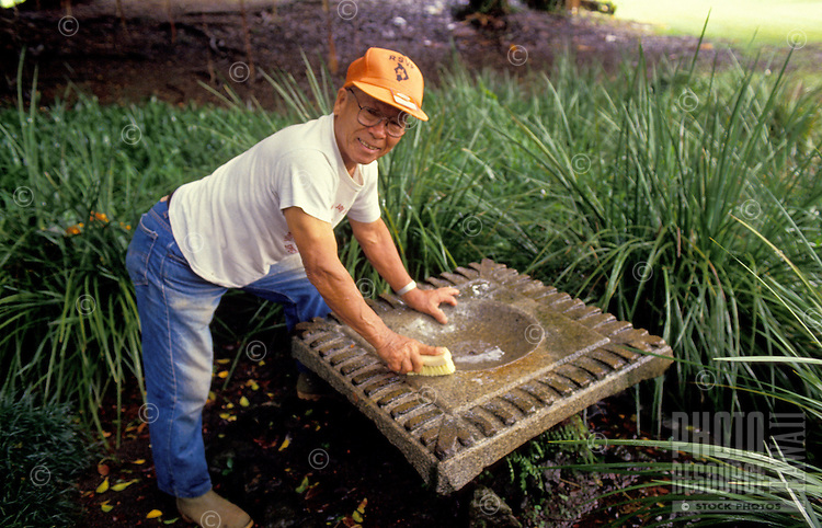 Man working and taking care of the park at Hilo, Hawaii