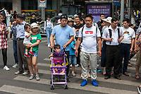 Suzhou, Jiangsu, China.  Chinese Pedestrians Waiting at a Crosswalk.