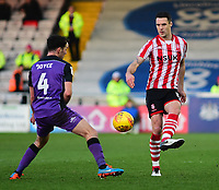 Lincoln City's Jason Shackell clears under pressure from Port Vale's Luke Joyce<br /> <br /> Photographer Andrew Vaughan/CameraSport<br /> <br /> The EFL Sky Bet League Two - Lincoln City v Port Vale - Tuesday 1st January 2019 - Sincil Bank - Lincoln<br /> <br /> World Copyright &copy; 2019 CameraSport. All rights reserved. 43 Linden Ave. Countesthorpe. Leicester. England. LE8 5PG - Tel: +44 (0) 116 277 4147 - admin@camerasport.com - www.camerasport.com