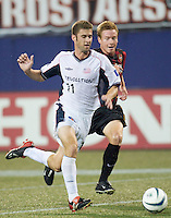 Chris Leitch of the MetroStars chases Pat Noonan, who was all the scoring power that the Revolution needed as he scored both New England goals as the NY/NJ MetroStars were defeated by the New England Revolution 2-1 on 9/13/03 at Giant's Stadium, NJ..