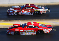 Sep 19, 2015; Concord, NC, USA; NHRA pro stock driver Erica Enders-Stevens (near) races alongside Greg Anderson during qualifying for the Carolina Nationals at zMax Dragway. Mandatory Credit: Mark J. Rebilas-USA TODAY Sports