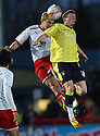 Mark Roberts of Stevenage and Jordan Cook of Carlisle (on loan from Sunderland) header. - Stevenage v Carlisle United - npower League 1 - Lamex Stadium, Stevenage - 17th April, 2012. © Kevin Coleman 2012