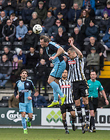 Garry Thompson of Wycombe Wanderers beats Haydn Hollis of Notts County in the air during the Sky Bet League 2 match between Notts County and Wycombe Wanderers at Meadow Lane, Nottingham, England on 28 March 2016. Photo by Andy Rowland.