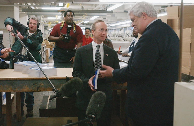 1/29/03.2004 FEDERAL BUDGET--Office of Management and Budget Director Mitchell E. Daniels Jr., and Public Printer of the United States Bruce R. James during a photo opp as copies of the Bush administration's Fiscal 2004 federal budget come off the binder at the U.S. Government Printing Office in Washington, D.C. The budget, which will be released Feb. 3, is 2,912 pages long and includes five volumes: Budget of the U.S. Government; Budget Appendix; Analytical Perspectives; Historical Tables; and Performance and Management Assessment. It will also be available on CD-ROM..CONGRESSIONAL QUARTERLY PHOTO BY SCOTT J. FERRELL