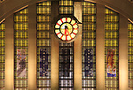 The Facade Windows And Clock Of The Cincinnati Museum Center At Union Terminal In It's Night Time Appearance, Lit From Inside And Outside, Cincinnati Ohio USA