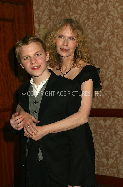 Mia Farrow and son Shamus at the 30th International Emmy Awards in New York. November 25, 2002. Please byline: Alecsey Boldeskul/NY Photo Press.   ..*PAY-PER-USE*      ....NY Photo Press:  ..phone (646) 267-6913;   ..e-mail: info@nyphotopress.com