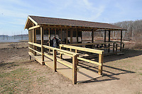 NWA Democrat-Gazette/FLIP PUTTHOFF <br /> Terry Stanfill shows a new wildlife viewing pavilion during a walk Feb. 10 2017 on the Eagle Watch Nature Trail. The pavilion is one of the improvements at the popular trail.