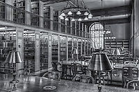 Stacks of books and research materials across from brass lamp equipped reading tables await researchers in the New York Public Library's Milstein Division of United States History, Local History and Genealogy (Genealogy Room).  The Genealogy Room is located in the Stephen A. Schwarzman Building on 5th Avenue and 42nd Street in New York City.