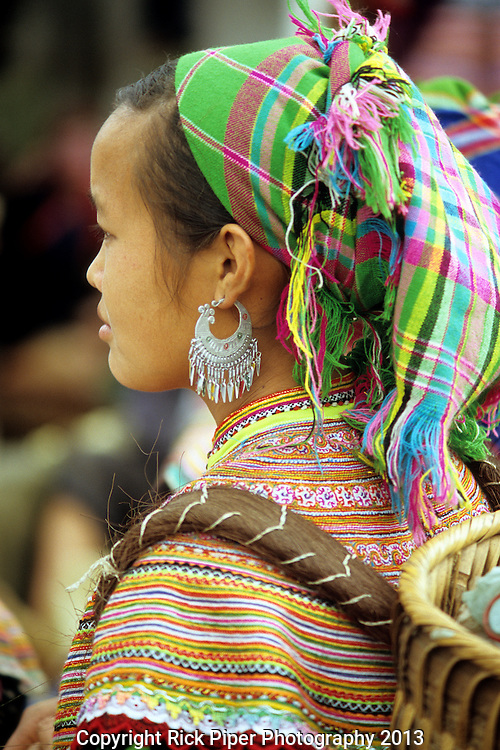 Flower Hmong Woman - Portrait of traditionally dressed young Flower Hmong woman at the Sunday market, Bac Ha, NW Viet Nam