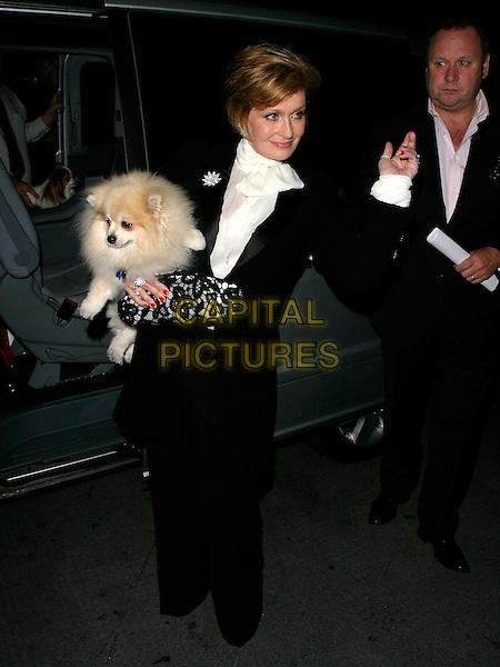 SHARON OSBOURNE.At The Bluebird Restaurant, Kings Road, .London, England, September 19th 2006..full length black suit white shirt clutch bag holding dog Maggie pet.REf: AH.www.capitalpictures.com.sales@capitalpictures.com.©Adam Houghton/Capital Pictures.