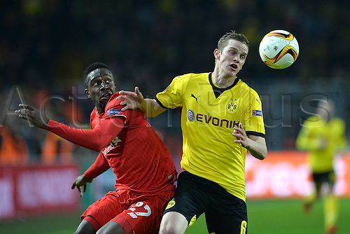 07.04.2016. Dortmund, Germany. Europa League quarterfinal. Borussia Dortmund versus Liverpool FC at the Signal Iduna Park Dortmund.  Divock Origi ( Liverpool ) beaten to the ball by Sven Bender ( Dortmund )