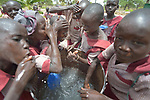 Students wash their faces in the Loreto Primary School in Rumbek, South Sudan. The Loreto Sisters began a secondary school for girls in 2008, with students from throughout the country, but soon after added a primary in response to local community demands.