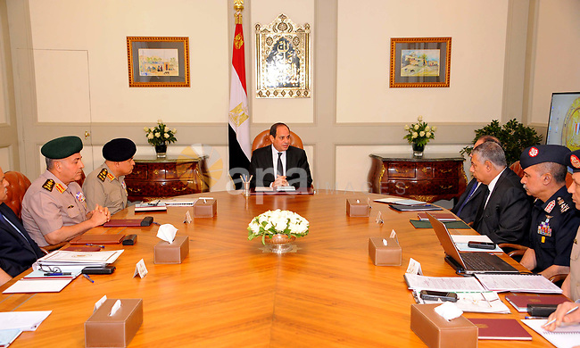 Egyptian President Abdel Fattah al-Sisi meets with leaders of the Supreme Council of the Armed Forces and the Supreme Council for Police after the gunmen attack in Minya, at the Ittihadiya presidential palace in Cairo, Egypt, May 26, 2017. Photo by Egyptian President Office
