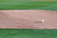 A Minor League Baseball rests on the mound before a California League game between the Visalia Rawhide and the Rancho Cucamonga Quakes on April 9, 2019 in Visalia, California. (Zachary Lucy/Four Seam Images)