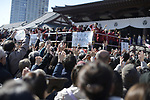 TOKYO, JAPAN - FEBRUARY 3: While chanting ortune in, Demons out, people gathered to catch for the lucky soybeans thrown from the balcony of Zojoji Temple in Tokyo on Feb. 3, 2019 to observe the annual mamemaki or the bean-throwing ceremony. The ritual ceremony, observed at temples and shrines throughout the country, is believed by Japanese to drive out the demons of misfortune and it is considered as the beginning of spring. (Photo: Richard Atrero de Guzman/Aflo)