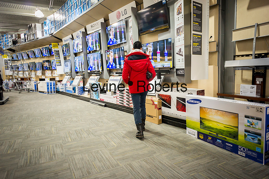 Flat-screen televisions on sale in a Best Buy electronics store in the Queens borough of New York on Sunday, December 5, 2013. The retailer is in a life and death struggle with Amazon and other online sellers and is fighting back by dropping and matching prices as well as cutting overhead. The stock shot up 240 percent on the strength of its comeback and other retailers are looking at its methods.  (© Richard B. Levine)
