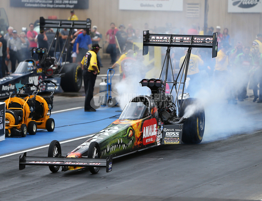 Jul 21, 2017; Morrison, CO, USA; NHRA top fuel driver Terry McMillen during qualifying for the Mile High Nationals at Bandimere Speedway. Mandatory Credit: Mark J. Rebilas-USA TODAY Sports