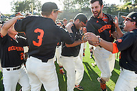 (Photo by John Valenzuela, Freelance)<br /> <br /> Head Baseball Coach Luke Wetmore gets soaked after the win. The Occidental College baseball team defeats Caltech to claim the SCIAC Championships on Sunday, May 1, 2016 at Oxy's Anderson Field.<br /> <br /> (Photo by John Valenzuela, Freelance)