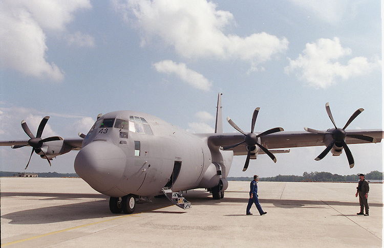 8/17/98.C-130J-30 HERCULES--Lockheed Martin crew members stand by a C-130J-30 Hercules cargo plane on the tarmac at Andrews Air Force Base..CONGRESSIONAL QUARTERLY PHOTO BY SCOTT J. FERRELL
