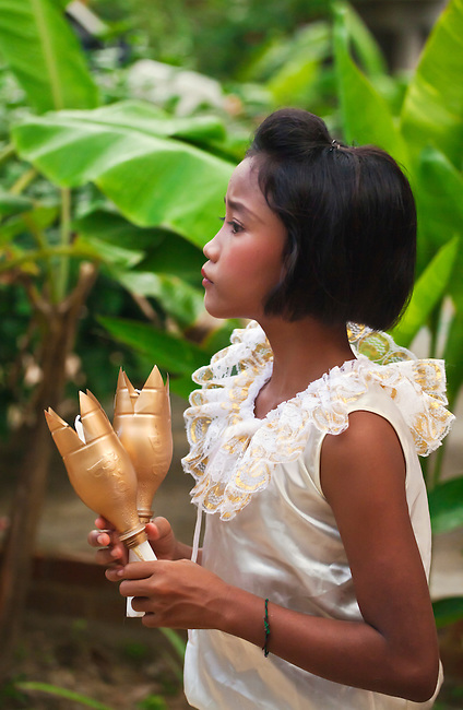 A Thai girl dresses up for a traditional dance during the  LOI KRATHONG FESTIVAL at the HOME AND LIFE ORPHANAGE in PHANGNGA  - KHAO LOK, THAILAND