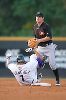 Second baseman Ryan Adams #3 of the Frederick Keys can't turn the double play as Salvador Sanchez #7 of the Winston-Salem Dash slides into second base at Wake Forest Baseball Stadium August 8, 2009 in Winston-Salem, North Carolina. (Photo by Brian Westerholt / Four Seam Images)
