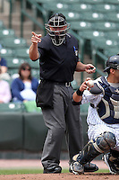 Home plate umpire Mark Lollo makes a call during a game between the Empire State Yankees and Durham Bulls at Frontier Field on May 13, 2012 in Rochester, New York.  Durham defeated Empire State 3-1.  (Mike Janes/Four Seam Images)