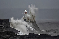 2018 12 18 Waves crash against the lighthouse in Porthcawl, south Wales, UK